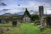 Old ruined Church and graveyard on the Lleyn Peninsula North Wales. poster