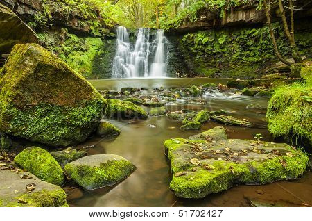 Goit Stock Falls are located in Airedale, West Yorkshire, UK. Waterfall on Harden Beck, which is a tributary of the River Aire, is accessible by  footpath leading from Harden to Cullinworth . poster