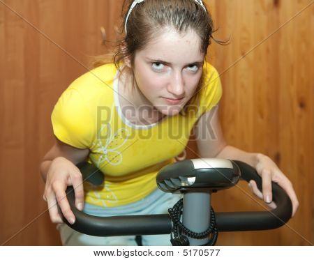 Girl On Exercycle