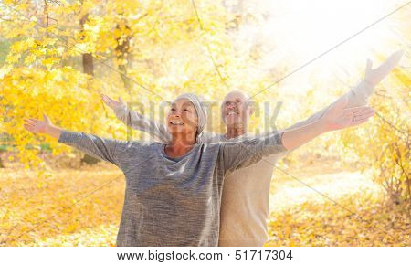 autumn couple  with outstreched arms