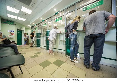 MOSCOW - APR 14: People are queuing for service in Department of Sberbank of Russia on April 14, 2013 in Moscow, Russia.