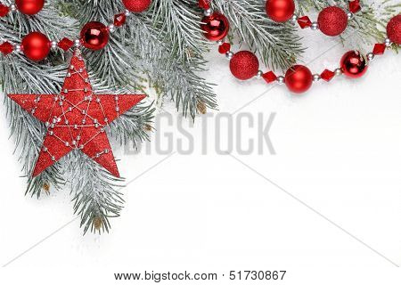 Christmas decoration with fir branch,Christmas star and balls.