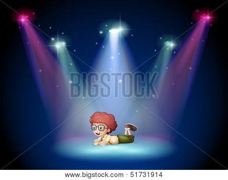 Illustration of a boy lying in the middle of the stage with spotlights