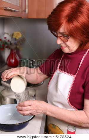 Grandmother Woman Is Cooking