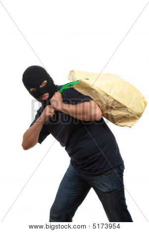 Robber In A Mask Carries Big Bag With Money