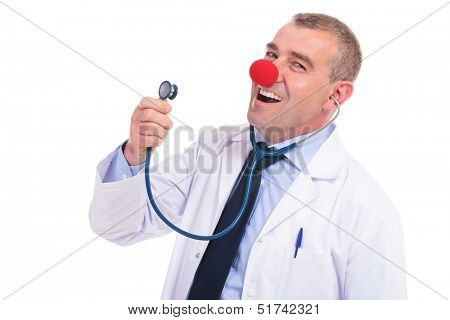 fake doctor with a red clown nose singing a song at his stethoscope
