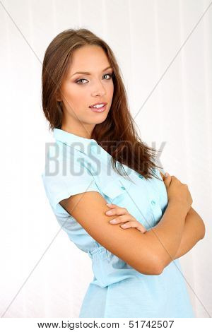 Young beautiful business woman in office