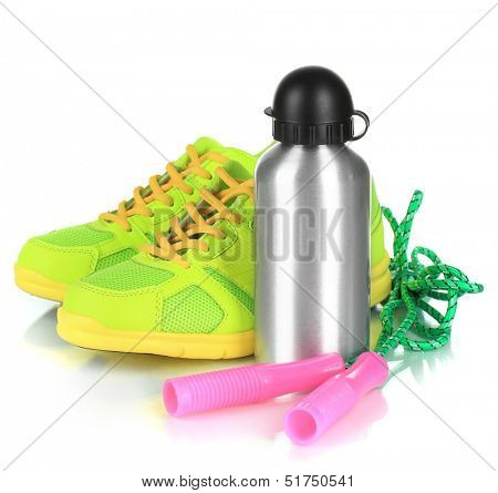 Sports bottle,sneakers and skipping rope isolated on white