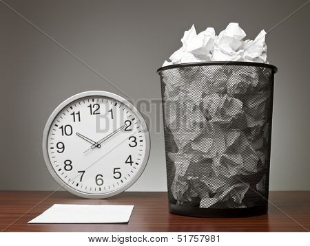 Recycle Bin and a clock in an office