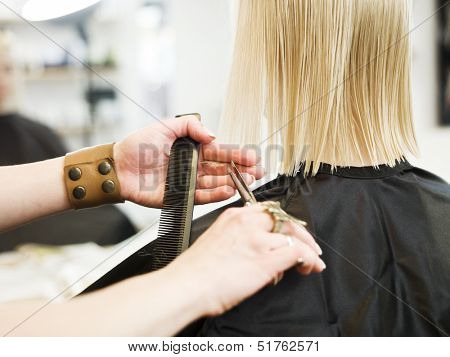 Close up of a scissor in action at the Hair Salon