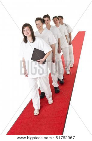 Medical Team on a red Carpet isolated on white background