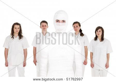 Mummyfied Patient in front of Healtcare Staff isolated on white background