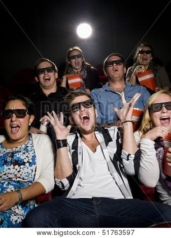 Scared Movie spectators with 3d glasses