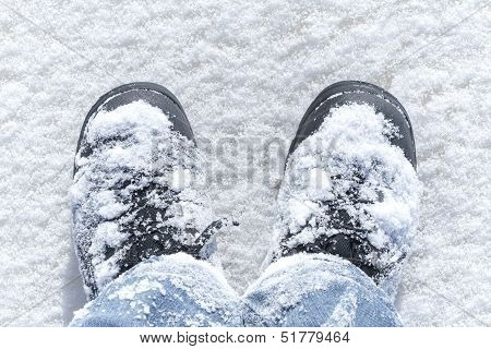 Winter Walking, Man's Legs In Boots With Show On It