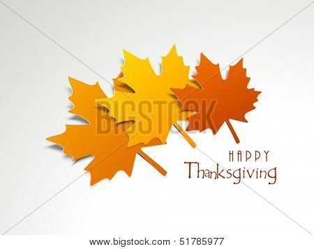 Happy Thanksgiving concept with maple leafs on grey background.