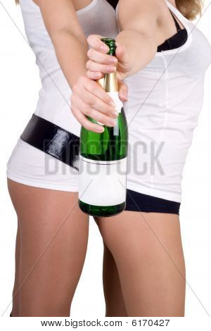 Two Girls With A Champagne Bottle. Isolated