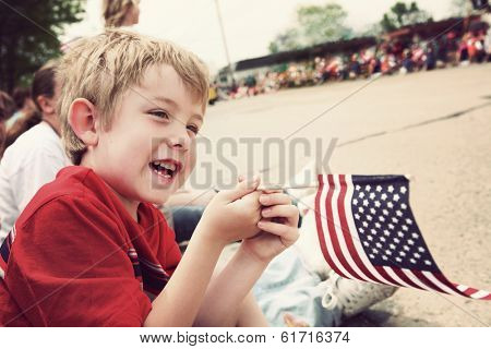 Young boy watching Holiday parade