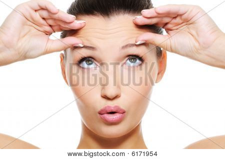 Female Face With Wrinkles On Her Forehead