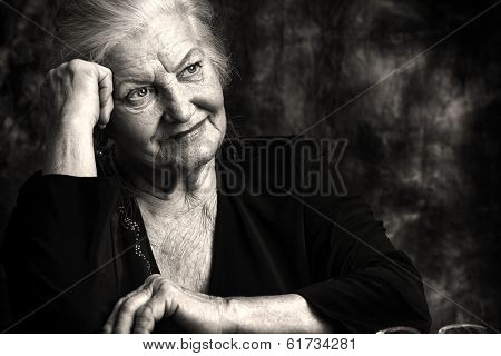 Portrait of a beautiful smiling senior woman. Black-and-white photo.