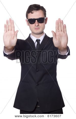 businessman with sunglasses showing stop