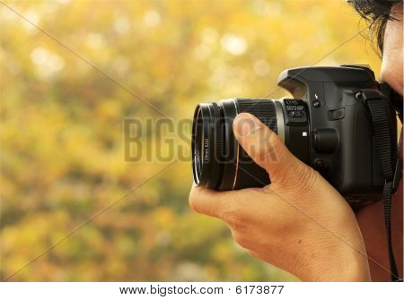 Photographer Taking A Shoot With A Digital Camera