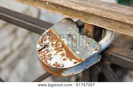 Old closed padlock rusty