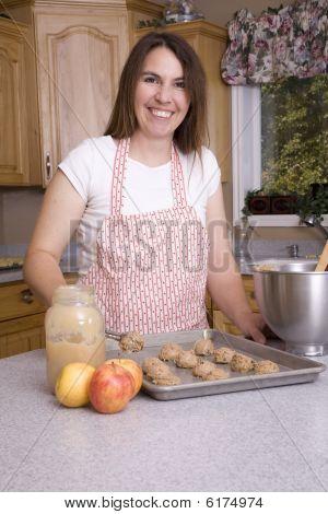 Woman Putting Cookies On Pan