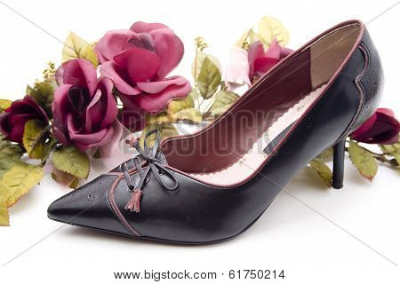 Black Lady Shoes with Red Flowers on white background