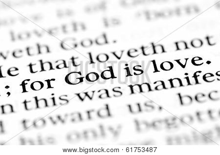 Detail closeup God is love scripture in bible verse