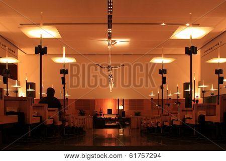 Unidentified man seating inside prayer hall
