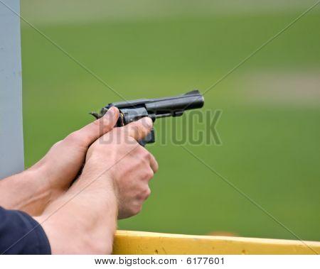 Hands With Gun