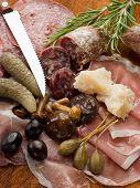 italian appetizer with salami, grana,speck,mushroom,cucumber poster