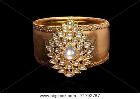 Close up of gold and diamond bracelet