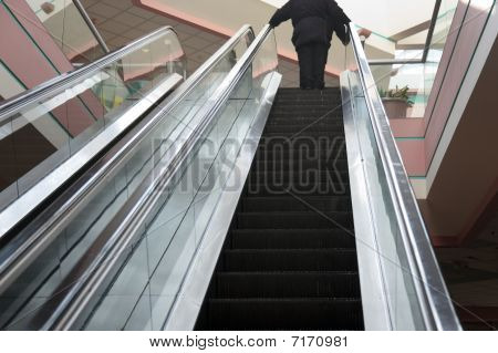 People On Ecalator At The Mall