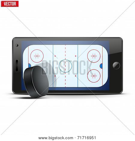 Mobile phone with ice hockey puck and field on the screen.