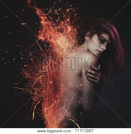 sensual beautiful latin woman with fire