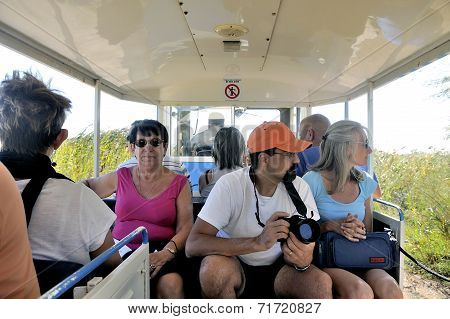 Tourists In The Tourist Train To Visit The Salt Business