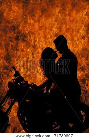 Silhouette Couple Kiss On Motorcycle Fire