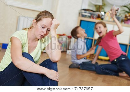 exhausted mother frustrated and upset from children behaviour