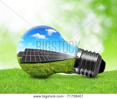 Solar panels in light bulb. Green energy concept.