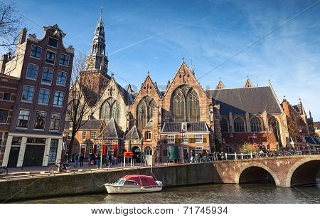 Amsterdam, Netherlands - March 19, 2014: Oude Kerk. Old Church On Canal Coast In Amsterdam. Ordinary