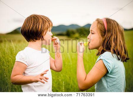 Children blowing whistle