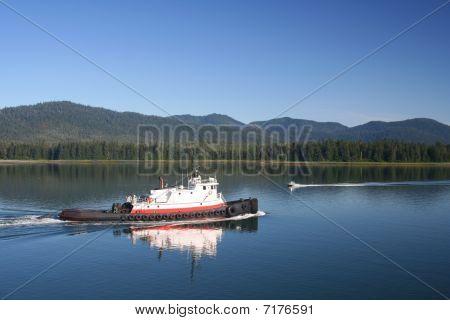 Tug Passing Speedboat