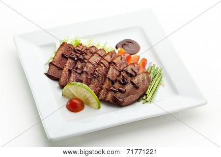 Roasted Breast in Sesame Sauce with Vegetables and Lime