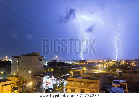 VALENCIA, SPAIN - SEPTEMBER 7, 2014: Lighting strikes near the airport in Valencia, Spain. Lightning strikes usually last around 1 or 2 microseconds and contains millions of volts of electricity.