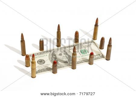 One hundred dollar bill fenced by cartridges