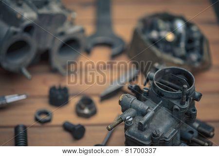 Carburetors for a car engine with tools