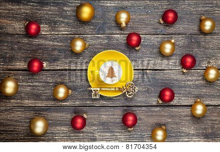 Cappuccino With Christmas Tree Shape And Key On Wooden Table