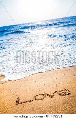 The Word Love Written In The Sand