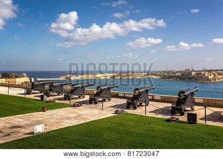 Battery of Cannons facing Harbor in Upper Barrakka Gardens in Valletta Malta poster
